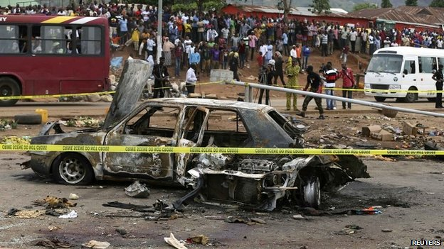 A damaged car at the scene of a bomb attack in Abuja - 2 May 2014