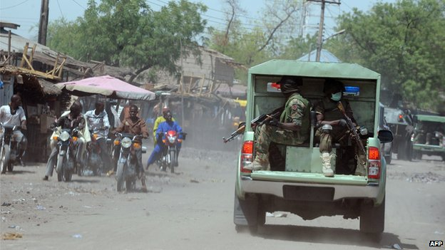 Joint Military Task Force (JTF) patrol the streets of restive north-eastern Nigerian town of Maiduguri, Borno State, on 30 April 2013