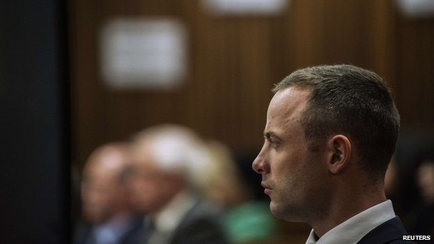 South African Olympic and Paralympic athlete Oscar Pistorius sits in the dock during his murder trial in the North Gauteng High Court in Pretoria, 8 May 2014