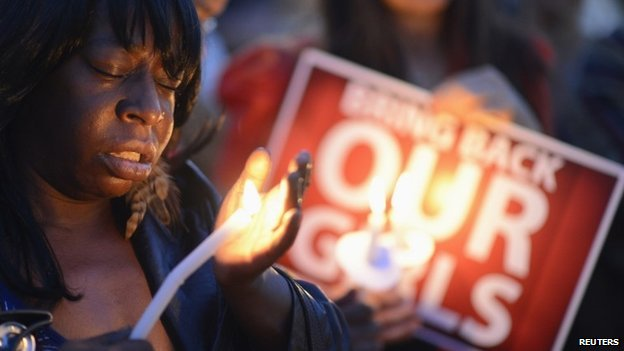 """People participate in a """"Bring Back Our Girls"""" campaign demonstration and candlelight vigil, held on Mother's Day in Los Angeles on 11 May 2014"""