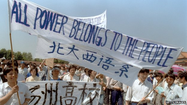 Waving banners, high school students march in Beijing streets near Tiananmen Square 25 May 1989 during a rally to support the pro-democracy protest against the Chinese government
