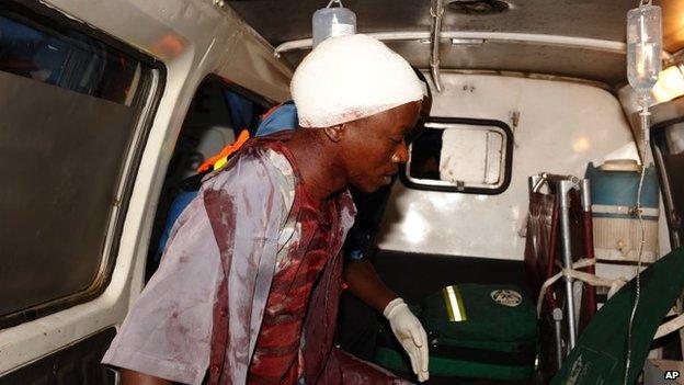 Injured man after grenade attack in Nairobi, Dec 2013