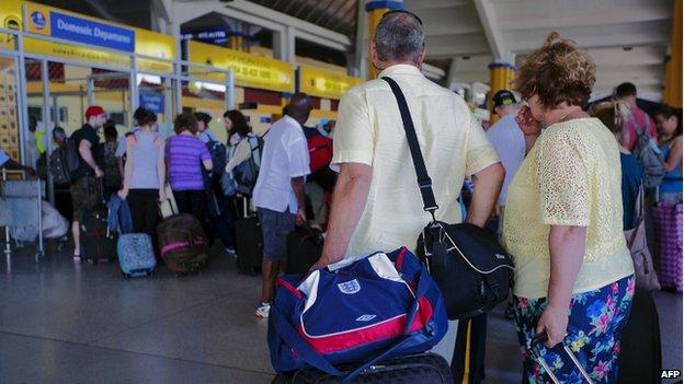 British tourists queue at the check-in at Mombasa airport (16 May 2014)