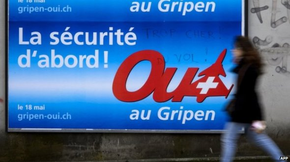 """Campaign posters promoting Swedish fighter jet Gripen and reading """"Security First! Yes to Gripen"""" in Lausanne (16 May 2014)"""