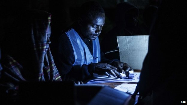 A Malawian Electoral Commission officer checks the stub of the used ballot papers on 20 May  2014 in Blantyre, Malawi