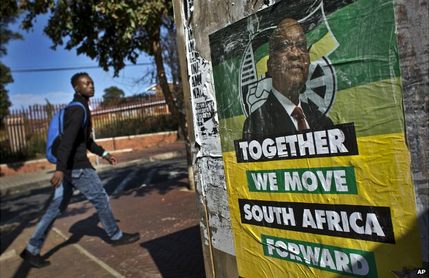 A man walks past an ANC party election poster in the Soweto township of Johannesburg - 9 May 2014