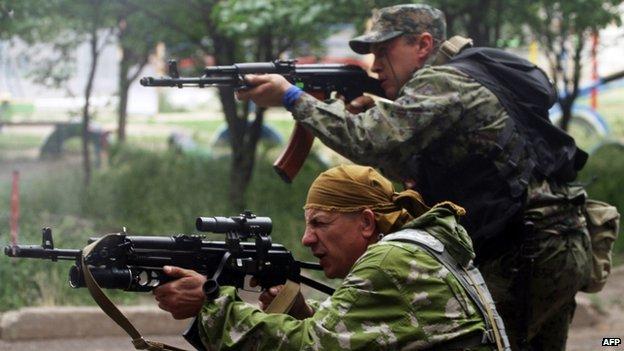 Pro-Russian gunmen fire at Ukrainian border guards in the Luhansk region. Photo: 2 June 2014