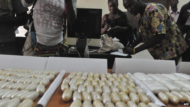 Packets of seized cocaine are displayed at a police station in Bissau on 21 March 2012, by the department in Guinea-Bissau in charge of anti-drug trafficking operations