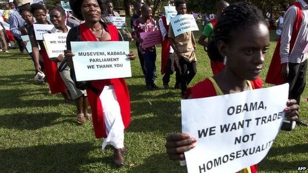 Anti-homosexuality activists march through the streets of Ugandan capital, Kampala, on 31 March 2014 in support of the government's stance against homosexuality
