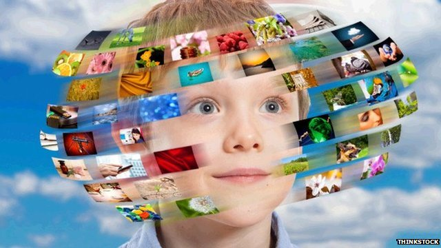 Boy with hundreds of digital images going around his head