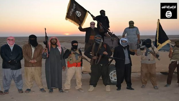 Screen grab from a propaganda video uploaded on 11 June 2014 by jihadist group the Islamic State of Iraq and the Levant (Isis) allegedly shows Isis militants gathering at an undisclosed location in Iraq's Nineveh province.