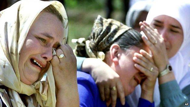 Bosnian Muslim women cry during the ceremony of the 6th anniversary of the Srebrenica massacre, in the village of Potocari, near Srebrenica on 11 July 2001.