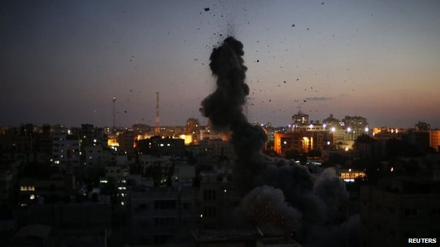 Shrapnel and debris fly after an explosion in what witnesses said was an Israeli air strike in Gaza City August 10