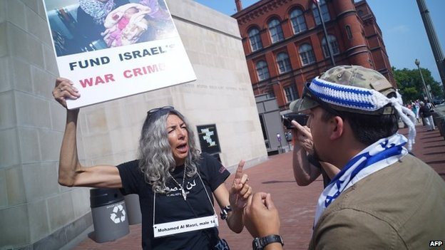 A woman demonstrating against Israeli action in Gaza argues with a supporter of Israel, during a rally outside of the Holocaust Museum on August 10