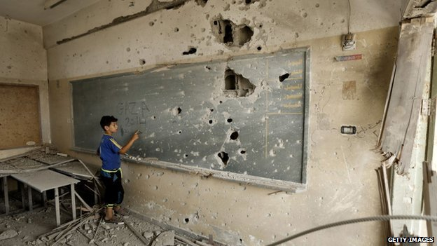 Getty images. A young boy at the blackboard of a school in Gaza, August 2014. Via BBC.