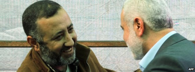 Mohammed Abu Shamala (L) with Hamas official Ismail Haniya in an image from 26 February