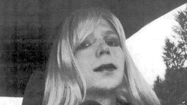 In this undated file photo provided by the US Army, Pte Chelsea Manning poses for a photo wearing a wig and lipstick