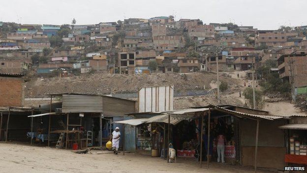 A view of the marketplace and homes of Gosen City, a slum in the Villa Maria del Triunfo municipality on the outskirts of Lima, March 17, 2014.