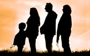 Three adults and child