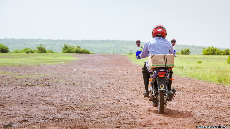 An eye surgeon on a motorbike in a remote region of Mali