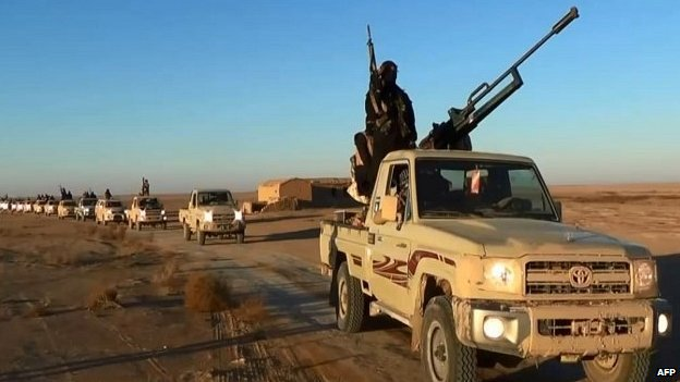 "An image grab taken from a propaganda video uploaded by jihadist group the Islamic State of Iraq and the Levant (ISIL) allegedly shows ISIL militants driving at an undisclosed location in Iraq""s Nineveh province."