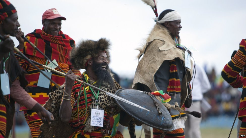 Men take part in a traditional dance during the 50th anniversary celebration of the formation of Arba Mintch town, Ethiopia on 6 September  2014
