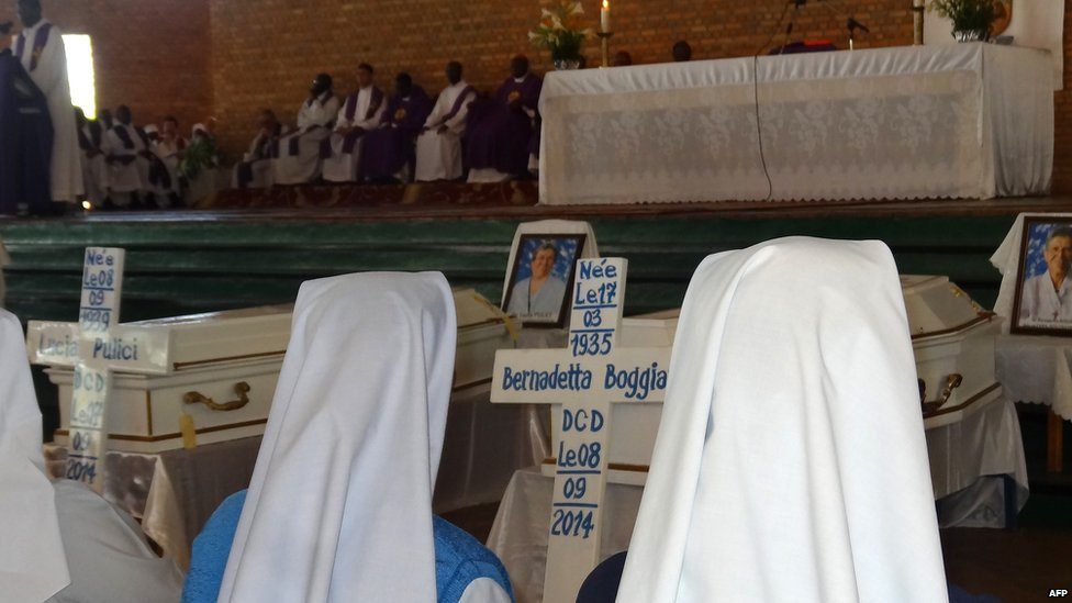 Nuns pray on 10 September 2014 at The Shrine of Mont Sion Gikungu in Bujumbura, Burundi, during a mass in memory of three Italian nuns who were raped and murdered in twin attacks in their convent