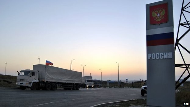 Lorries, part of a Russian humanitarian convoy, cross the Ukrainian border