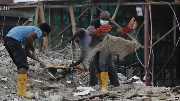 Rescue workers search for survivors in the rubble of a collapsed building belonging to the Synagogue Church of All Nations in Lagos, Nigeria, Tuesday 16 September 2014