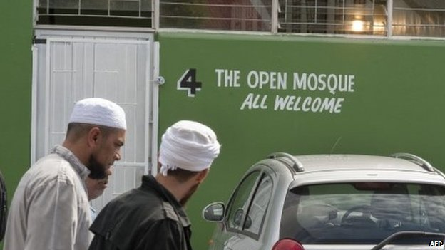 Muslims walk near the entrance of the Open Mosque, on its opening day, on September 19, 2014 in Wynberg, Cape Town.