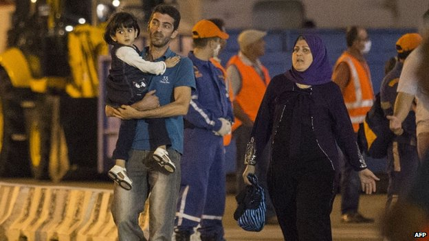 Migrants leave the cruise ship. 25 Sept 2014
