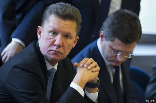 Gazprom CEO Alexei Miller (L) and Russian Energy Minister Alexander Novak wait for the start of gas talks between the EU, Russia and Ukraine in Berlin, 26 September