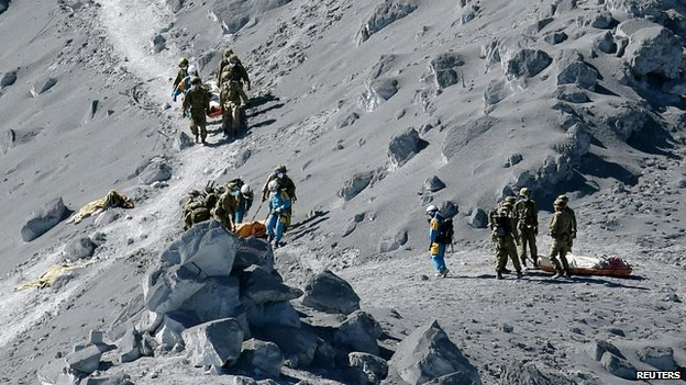 Bodies of victims brought down mountain. 28 Sept 2014