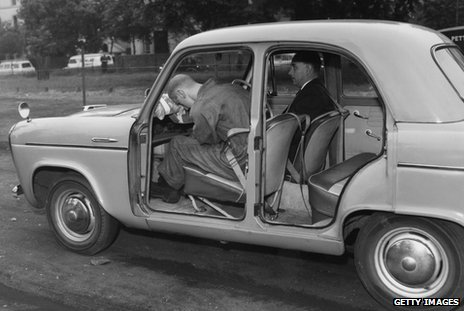 A 1960 demonstration of a crash without seatbelt. A dummy is propelled forward into the dashboard