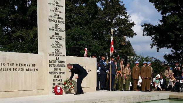 The Polish ambassador Witold Sobkow lays a wreath at the Polish War Memorial near RAF Northolt