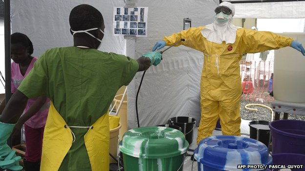 A health worker is decontaminated at a treatment centre