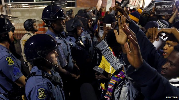 Protesters stand-off against police during a protest in Ferguson, Missouri October 10, 2014