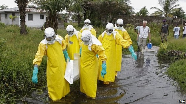 File photo: A Liberian burial squad carry the body of an Ebola victim in Marshall, Margini county, Liberia, 25 September 2014