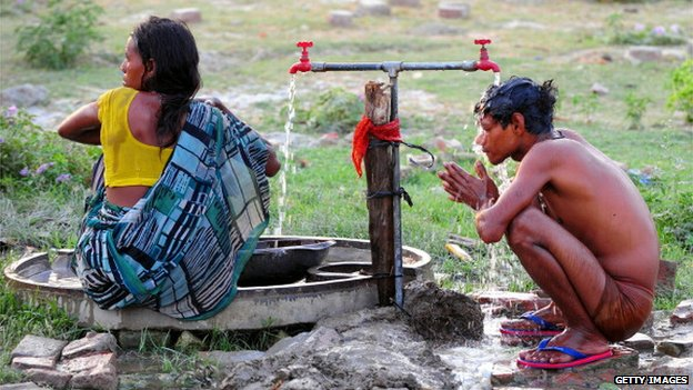 Girl and boy washing in India
