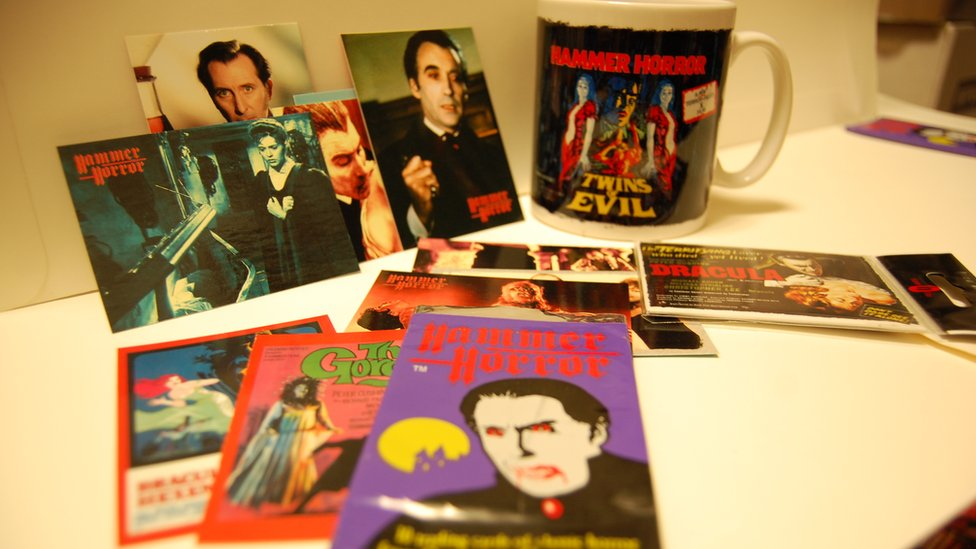 A mug and postcards