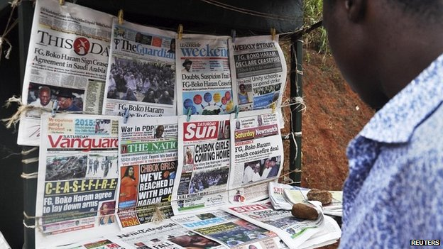 Newspapers with headlines on the Chibok girls and their possible release are displayed at a news stand in Abuja - 18 October 2014