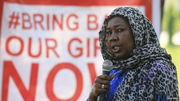 "A campaigner from ""#Bring Back Our Girls"" addresses a rally calling for the release of the Abuja school girls who were abducted by Boko Haram militants (1 November 2014)"