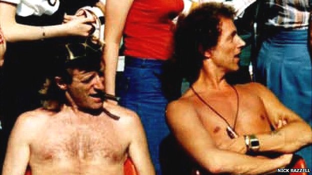 Jimmy Savile and Ray Teret together, sitting bare-chested - date and place unknown