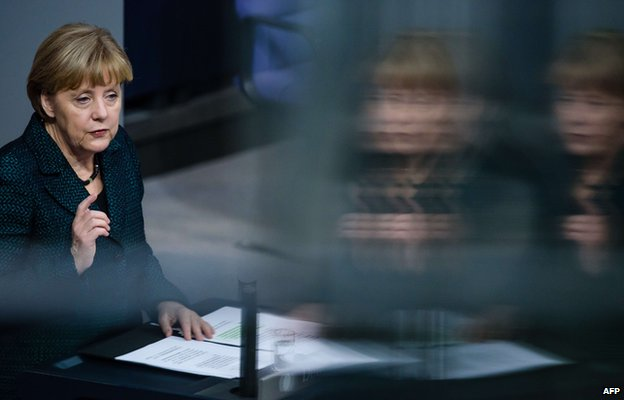 German Chancellor Angela Merkel addresses a session of the Bundestag (Lower House of Parliament) in Berlin on November 26, 2014