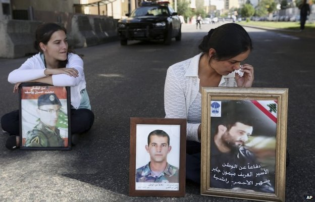 Relatives of Lebanese soldiers captured by Islamic State and al-Nusra Front at a demonstration in Beirut demanding the Lebanese authorities take action to secure their release (22 October 2014)