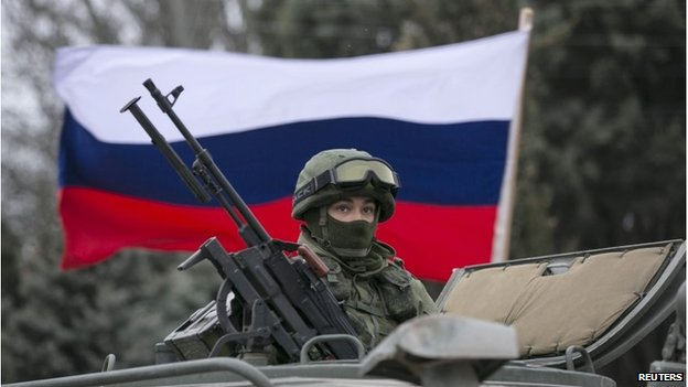 Russian flag behind a Russian army vehicle outside Balaclava, 1 March 2014