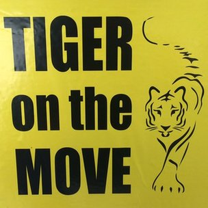 Label saying 'Tiger on the move'