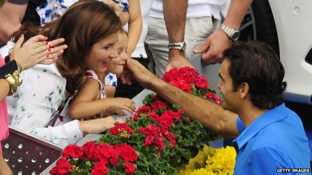 Federer celebrates Madrid Masters final win with wife and daughter