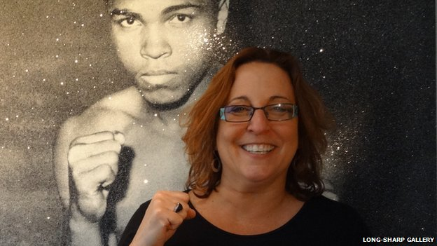 Rhonda Long-Sharp with picture of Muhammed Ali