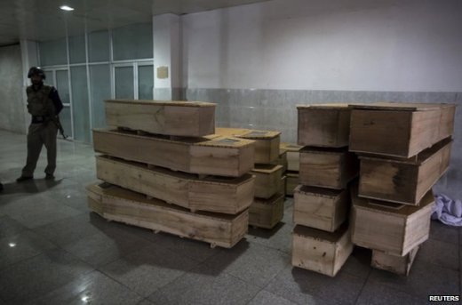 Empty coffins stacked at a hospital in Peshawar, 16 December
